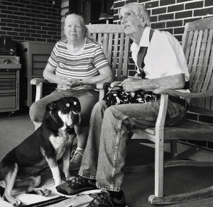 two older people and a dog