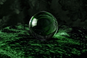a crystal ball in a field of green material that is used to illustrate cannabis in 2020