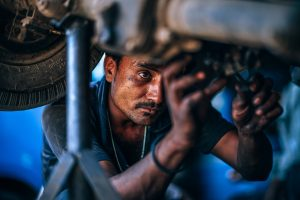 an auto mechanic working on a car