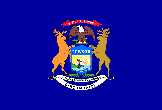 the state of Michigan flag with the state's motto and some wildlife